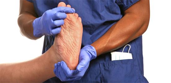 doctor handling foot calluses